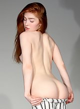 Stunning redhead with pale skin stripping and spreading
