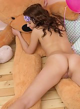 Cute brunette teen posing with a teddy bear