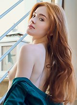Gorgeous redhead pulls her panties aside