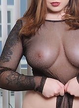 Chubby brunette with big tits takes off her see-through bodysuit