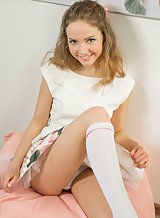 Adorable blonde teen takes off her panties