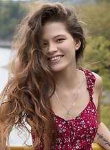 Long-haired teen lifts up her dress in public