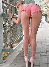Leggy blonde in pink jean shorts