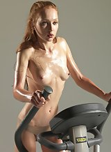 Skinny redhead working out
