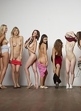 Eleven hot girls getting naked together