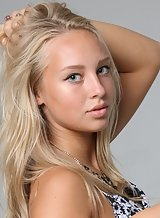 Gorgeous blonde teen posing topless