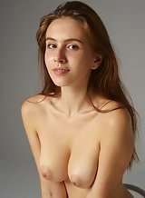 Stunning brunette with big natural tits posing nude