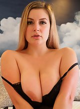 Chubby blonde with big tits spreads her pussy