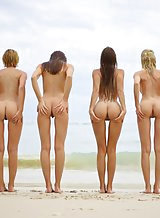 Four hot girls nude at the beach