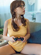 Nerdy brunette teen playing video games naked