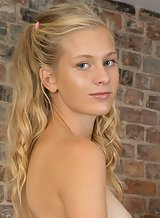 Shaved blonde teen with tan lines takes off her panties