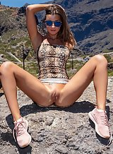 Sexy brunette Maria spreading by a cliff