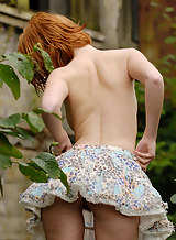 Fair skinned redhead Clelia shares her soft curvy nude body
