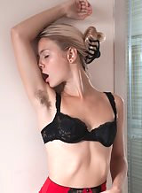 Hairy blonde girl in stockings spreading