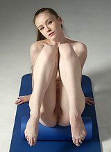 Busty pale babe Emily Bloom streches her flexible nude body