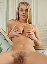 Busty hairy blonde masturbating on a chair