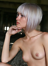 Sexy blonde girl nude in an old building