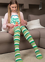 Shaved teen in striped socks spreading
