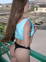 Long-haired girl takes off her thong