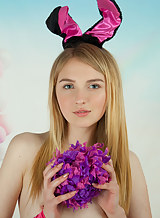 Flat-chested blonde teen dressed as a bunny
