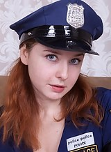 Chubby redhead with big tits in a police uniform spreading her hairy pussy